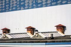 The roofs of a factory hall. The roofs of a factory building with air ducts in which large yachts are built on the edge of Vlissingen Stock Image