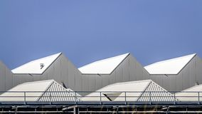 The roofs of a factory hall. The roofs of a factory building in which large yachts are built on the edge of Vlissingen Stock Photos