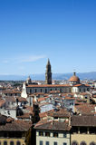 Roofs of Firenze. View at church Santo Spirito, skies and mountains at background Royalty Free Stock Photography