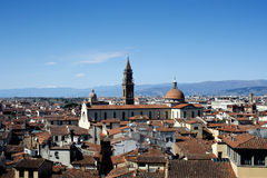 Roofs of Firenze. View at church Santo Spirito, skies and mountains at background Stock Image