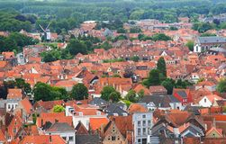 Roofs of Flemish Houses and windmill in Brugge Stock Photography