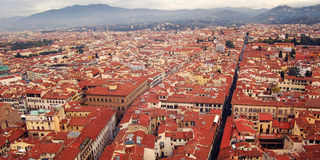 Roofs of Florence from Florence Cathedral belfry. Roofs of Florence from Campanile of Florence Cathedral. Aged photo. View of Firenze city with Basilica of Stock Photography