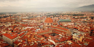 Roofs of Florence from Florence Cathedral belfry. Roofs of Florence from Campanile of Florence Cathedral. Aged photo. View of Firenze city with Basilica of Royalty Free Stock Photography