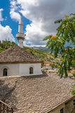 Roofs Gjirokaster mosque with minaret Royalty Free Stock Images