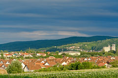 Roofs of houses. Panoramic view of small city with emphasis on roofs of houses Stock Image