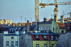 Roofs of houses, chimneys, antennas and cranes Royalty Free Stock Photography