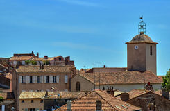 Roofs of houses and the church tower Royalty Free Stock Photo