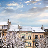 Roofs of houses covered with snow. Stock Photo