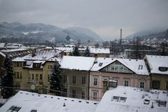 Roofs of houses covered by snow during winter. Slovakia Stock Photos