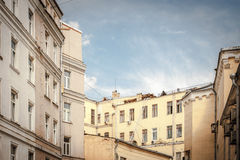 Roofs of the houses in Moscow courtyard under the blue sky Stock Image
