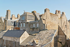 Roofs and houses of Saint Malo in summer with blue sky. Royalty Free Stock Image