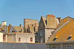 Roofs and houses of Saint Malo in summer with blue sky. Brittany. Royalty Free Stock Image