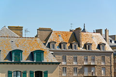 Roofs and houses of Saint Malo in summer with blue sky. Brittany. Stock Photo