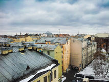 The roofs of houses. In St. Petersburg in winter. The rooftops of the old town. Old house top view stock photo