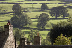 Roofs of houses and trees on fields in Yorkshire Dales Yorkshire England Stock Photography