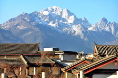 Roofs with Jade Dragon Snow Mountain royalty free stock images
