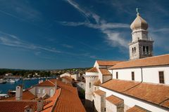 Roofs in Krk. The church tower in the town of Krk, Croatia stock photography
