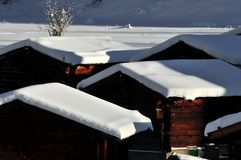 Roofs of log cabins in the snow Royalty Free Stock Photo