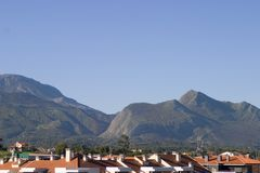 Roofs and mountains. View of the roofs and the mountains which surround a small village of the Spanish north coast Royalty Free Stock Images