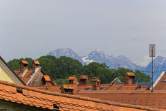 Roofs and mountains. Royalty Free Stock Photo