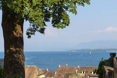 The roofs of Nyon. Beautiful view to roofs the old city of Nyon and blue Leman lake. Canton Vaud Switzerland Royalty Free Stock Images