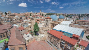 Roofs of Old City with Holy Sepulcher Church Dome timelapse, Jerusalem, Israel. Top view with blue cloudy sky stock video footage