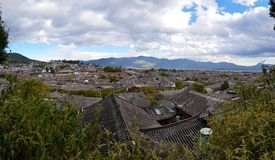 The roofs of the old city of Lijiang, Yunnan, China. Panorama on the roofs of the old city of Lijiang, Yunnan, China stock photo