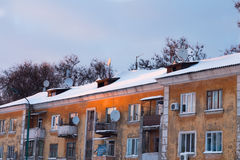Roofs of old houses in orange setting sun Royalty Free Stock Images