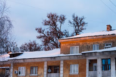 Roofs of old houses in orange setting sun Stock Image