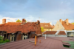 Roofs of old houses warmed by the sun Stock Photos