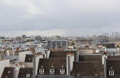 Roofs of Paris on a cloudy day, France, Europe. royalty free stock photos