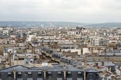 Roofs of Paris with moody sky Stock Image