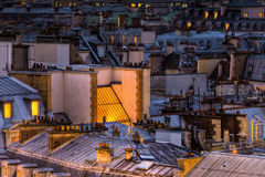 Roofs of Paris at night Royalty Free Stock Photos