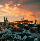 Roofs of Prague and St. Vitus Cathedral in the evening Stock Photos