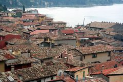 Roofs of Resort Malcesine. View on resort Malcesine roofs and Lago di Garda lake Royalty Free Stock Image