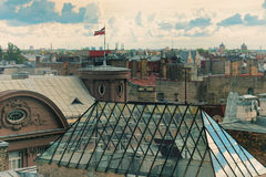 Roofs of Riga with the national flag of Latvia Stock Photography