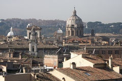 The roofs of rome, Italy. An aerial view of the roofs of the ancient city of Rome in Italy. Some churches with domes Stock Photos