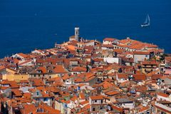 Roofs and a sailboat Royalty Free Stock Images