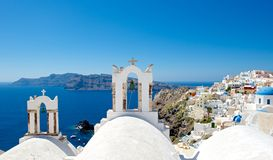Roofs of Santorini. Architecture Greek cities very distinctive. Comfortable white houses and churches with bright color accents, very nice looking at the Stock Photo