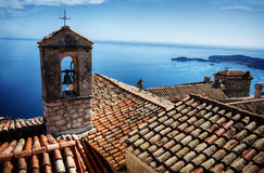 Roofs with sea view. View of the sea in cote d'azur with church bell and roofs Royalty Free Stock Photos