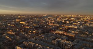 The roofs of St. Petersburg aerial drone river Neva. The roofs of St. Petersburg in the rays of the setting sun, aerial photography from the drone. The rays of stock video