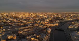 The roofs of St. Petersburg Aerial drone. The roofs of St. Petersburg in the rays of the setting sun, aerial photography from the drone. The rays of the setting stock video
