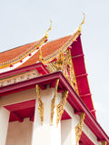 Roofs. Throne Phutthaisawan Gray with brightly orange roofs stands in front of National Museum of Thailand Royalty Free Stock Photo