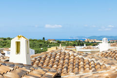 Roofs of tiles in an urbanization of houses, Sardinia. Roofs of tiles in an urbanization of houses with views to the sea in Sardinia, Italy Royalty Free Stock Photos