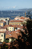 Roofs of Trieste city with the Barcolana regatta. In background Royalty Free Stock Photography