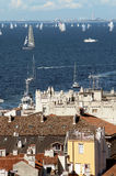 Roofs of Trieste city with the Barcolana regatta. In background Royalty Free Stock Photos