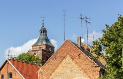 Roofs with TV antennas. And church tower in the background Royalty Free Stock Images