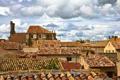 Roofs Under Cloudy Sky Stock Image