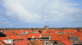 Roofs and windmills Stock Photo
