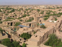 The Roofs of Yazd. From high above Yazd, Iran, this sweeping shot illustrates life in this amazing country. Mudbrick houses abound in this amazing city Royalty Free Stock Photo